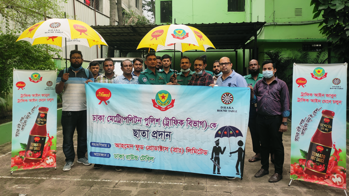 Dhaka Metropolitan Traffic Department was given umbrella by Ahmed Food Products.